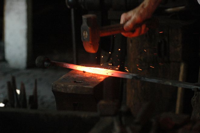 1280px-Blacksmith_working